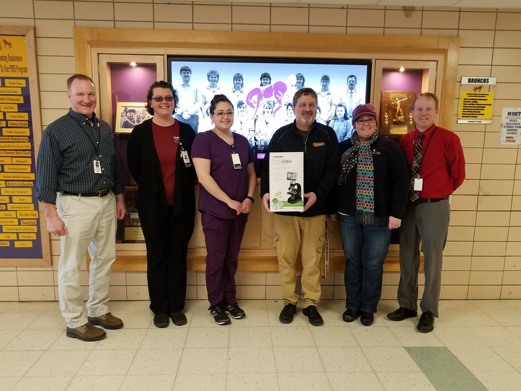 Staff Accepting Microscope Donation from RLMC